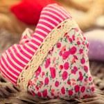 Valentine's Day. Handmade fabric heart over wood background — Stock Photo #44266771