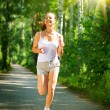 Running Woman. Outdoor Workout in a Park. Full Length Portrait — Stock Photo #44267677