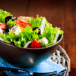 Greek Salad Bowl with Feta Cheese, Tomatoes and Olives — Stock Photo #44268595