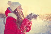 Beauty Winter Girl Blowing Snow in frosty winter Park. Outdoors — Stock Photo