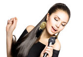 Singing Woman. Beauty Woman with Microphone — Stock Photo