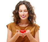 Beauty Young Woman with Valentine Heart in her hands — Stock Photo