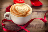Valentine's Day Coffee or Cappuccino with heart on foam — Stock Photo