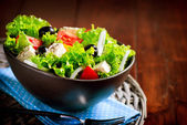 Greek Salad Bowl with Feta Cheese, Tomatoes and Olives — Stock Photo