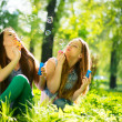 Teenage girls blowing soap bubbles — Stock Photo #48638133