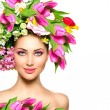 Girl with colorful flowers hairstyle — Stock Photo #48638305