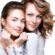 Mother and smiling teenage daughter — Stock Photo #48638567