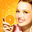 Beauty model girl with juicy oranges. Freckles — Stock Photo #48638583