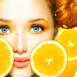 Model girl with juicy oranges. — Stock Photo #48638695