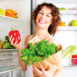 Woman near the refrigerator with food — Stock Photo