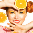 Model girl takes juicy oranges. — Stock Photo #48638745