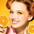 Model girl with juicy oranges. — Stock Photo #48638767