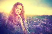 Woman  with Violet Flowers — Stock Photo