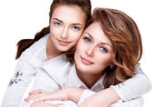 Mother and smiling teenage daughter — Stock Photo