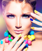 Beauty model girl with colorful nails — Stock Photo