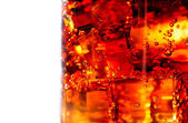 Cola with ice and bubbles in glass — Stockfoto