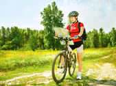 Young woman riding bicycle outside — Stock Photo