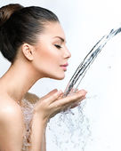 Woman with splashes of water — Stockfoto