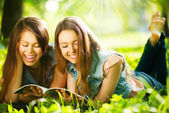 Teenage girls reading a magazine — Stock Photo