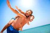 Father and Son having fun at the beach. — Stock Photo