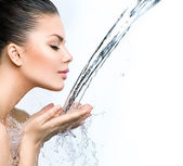 Woman with splashes of water — Stock Photo