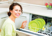 Woman in the Kitchen doing Housework — Stock Photo