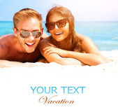 Couple in Sunglasses on the Beach. — Stock Photo