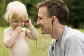 Happy father and the son listen to music — Stock Photo