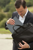 Businessman gets the laptop from a business bag. Business concep — Stock Photo