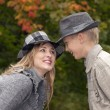 Happy mother and son in autumn park — Stock Photo