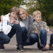 Happy family having fun in park — Stock Photo
