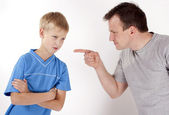 Strict father punishes his son. Isolated on white background — Stock Photo