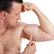 Strong man measuring his bicep muscle. Isolated on white backgro — Stock Photo