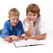 Two happy children with the book — Stock Photo