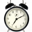 A classic old black alarm clock on white background — Stock Photo