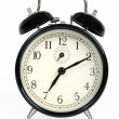 A classic old black alarm clock on white background — Stock Photo #13601403
