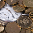 Time is money concept. Coins and an old pocket-watch. — Stock Photo