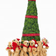 Teddy bears with scarf and Christmas hat under a Christmas tree. — Stock Photo #14115734
