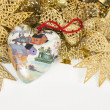 Old handmade  holiday decoration with toy Christmas heart - Stock Photo