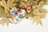 Old handmade holiday decoration with toy Christmas heart — Stock Photo