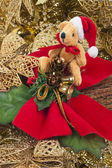 Gold background with red bow and xmas bear — Stock Photo