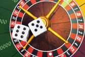 Cubes on roulette background — Stock Photo