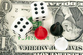 Board game figures and two dice against a banknote — Stock Photo