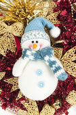 Snowman on a Christmas background — Stockfoto