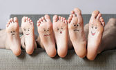 Close up of human soles with smiles — Stock Photo