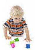 Blonde child playing educational toys isolated on white — Stock Photo