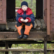 Сhild sits in the car of the old train — Stock Photo