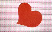 Heart from paper on a checkered background. Valentine — Stockfoto