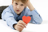 Schoolboy with red hearts. — Stock Photo