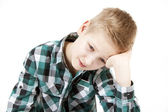 Boy propping his head on his hand — Stock Photo